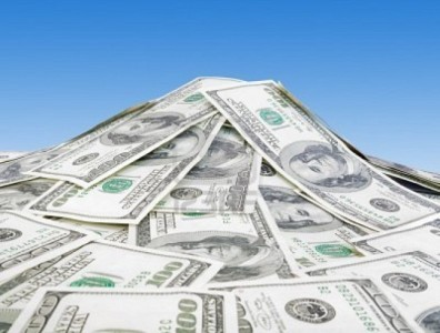 4949741-big-pile-of-money-over-blue-background