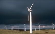 A16PFE Wind turbines against a stormy sky, Llandinam, Powys